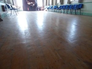 DIY attempt at sanding a wooden hall floor in a village outside of Barrow In Furness