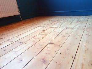 white oil on pine floor board following sanding